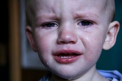 Crying boy. Portrait of a crying baby boy Stock Images