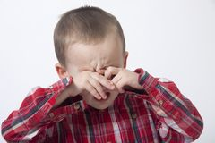 Crying boy. Portrait of crying boy in a studio Royalty Free Stock Image
