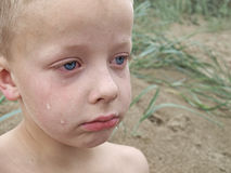Crying boy. Boy at the beach crying Royalty Free Stock Photos