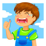 Crying boy. Little boy crying because of a cut on his thumb Stock Photo