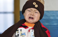 A crying boy. Of china Royalty Free Stock Photography
