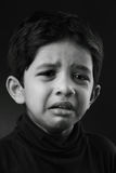 Crying boy. Black and white image of a crying kid Royalty Free Stock Images