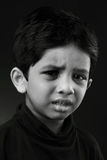 Crying boy. Black and white image of a crying kid Royalty Free Stock Image