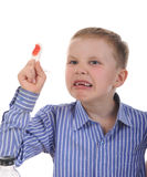 Crying boy with a bandaged finger. Royalty Free Stock Photography