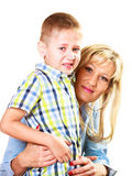 Crying boy child with his mother portrait Royalty Free Stock Image