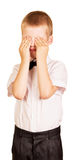 Crying boy covers his face with hands isolated on white. Stock Images