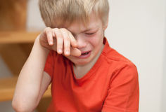 Crying boy Stock Images