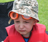 Crying boy in life jacket Stock Photos