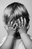 Crying boy. Monochrome photo on grey Stock Photography