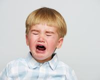Crying boy in studio shot Royalty Free Stock Photo
