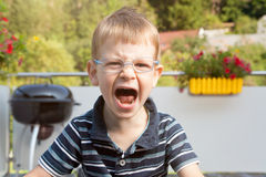 Crying boy on terrace Royalty Free Stock Image