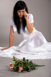 Crying bride. Focus on flovers Royalty Free Stock Image