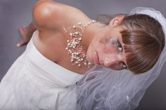 Crying bride on the ground Royalty Free Stock Image
