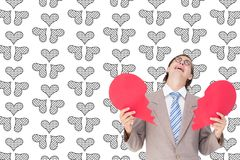 Crying businessman holding broken heart Stock Photos