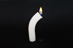 Crying candle. White candle shining on the black background stock photography