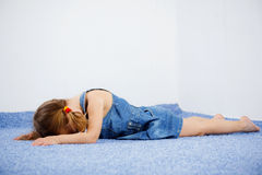Crying child. Lying on the floor Royalty Free Stock Image