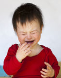 Crying child. Portrait of a  little boy in a red top  crying in frustration Stock Photography
