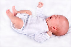 The crying child. On a white background Royalty Free Stock Photo