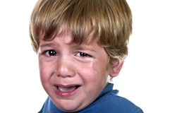 Crying child. Closeup of a crying boy, studio shot Royalty Free Stock Photo