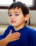 Crying child. A little child is truly crying and showing his emotions with his hand on the chest Stock Photos