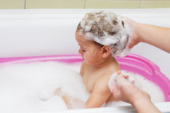 Crying child bathing Stock Images