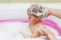 Crying child bathing. Crying child during bathing and washing hair Stock Images