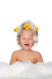 Crying child with ducks and soap foam Stock Photos
