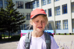 Crying child. Crying girl in front of the school Royalty Free Stock Images