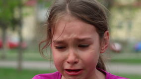Crying child in grief and sadness. Child crying with tears on face stock video footage