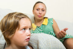 Crying child and mother having quarrel Stock Photos