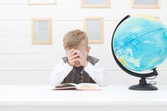 Crying Child. school, education kid. Crying Child, in school. little boy with Book, Children Education Royalty Free Stock Photos