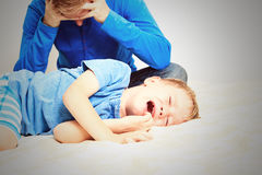 Crying child, tired father Stock Photo