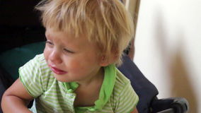 Crying child. Crying two year old child in a buggy stock footage