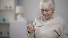 Crying elderly lady eating dinner, suffering from loneliness in old age, closeup. Stock footage stock footage
