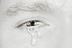 Crying eye with Syria Flag. Crying eye with Syria Independence National Coalition Flag iris on black and white face. Concept of sadness for Syrian civil war Royalty Free Stock Photo