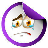 Crying face on purple sticker Royalty Free Stock Images