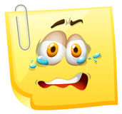 Crying face on yellow paper Royalty Free Stock Photography
