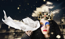 Crying fairytale queen wiping tears with tissue Stock Image