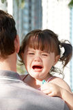 Crying on father's shoulder Stock Photography
