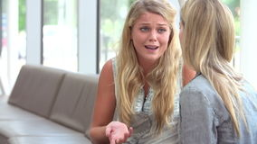 Crying Female College Student Talking To Counselor