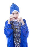 Crying female muslim in blue dress - isolated Stock Images