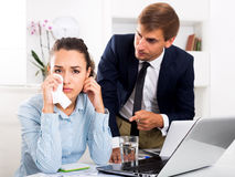 Crying female office employee made a mistake Royalty Free Stock Photography