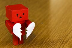 Crying figure with broken heart