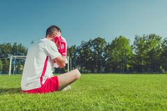 Crying Football Fan. Crying Polish Football Fan After Lost Match. European Soccer Mundial Theme. Polish National Team Colors Wearing Royalty Free Stock Photography