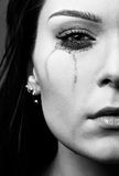 Crying girl. Close-up portrait of beautiful crying girl with smeared mascara Royalty Free Stock Photos