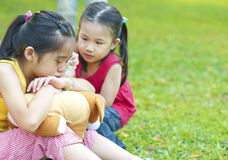 Crying girl. Little girl is comforting her crying sister stock photo