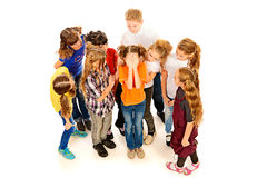 Crying girl. Children stand around crying girl. Isolated over white Royalty Free Stock Photography