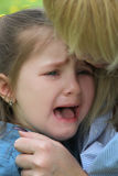 Crying girl close-up conforted Royalty Free Stock Photos
