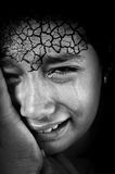 Crying girl with cracked Stock Photography