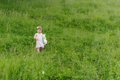 Crying Girl in Grass Stock Images